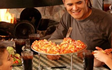 Family With Kids Eat Pizza
